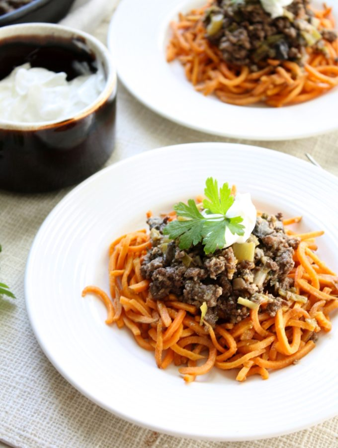An awesome healthy version of Beef Stroganoff with healthy protein packed yogurt and sweet potato noodles. Gluten free and done in 30 min or less!